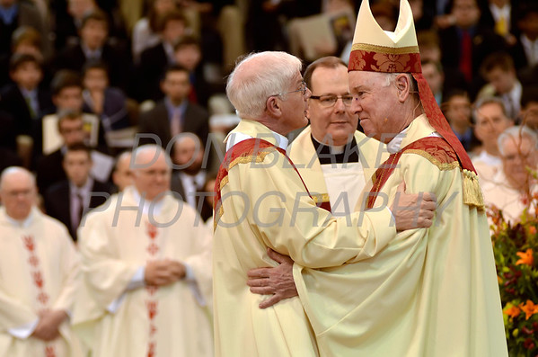 Mike Vogt receives the Hug of Peace from Bishop Malooly during his Ordination in the Gym of Salesianum School, Wilmington, Del., Friday, January 27, 2012. Mike Vogt ask Bishop Malooly for permission to have his Ordination in the gym of Salesianum School where he is a teacher. photo/Don Blake Photography.com