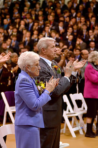 Mike Vogt's parents Mary and Albert Vogt and all in attendance clap at the conclusion of his Ordination in the Gym of Salesianum School, Wilmington, Del., Friday, January 27, 2012. Mike Vogt ask Bishop Malooly for permission to have his Ordination in the gym of Salesianum School where he is a teacher. photo/Don Blake Photography.com