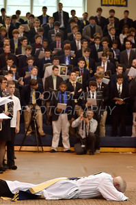 Mike Vogt prostrates him self as Bishop Malooly, his parent (left) and all in attendance pray during his Ordination in the Gym of Salesianum School, Wilmington, Del., Friday, January 27, 2012. Mike Vogt ask Bishop Malooly for permission to have his Ordination in the gym of Salesianum School where he is a teacher. photo/Don Blake Photography.com