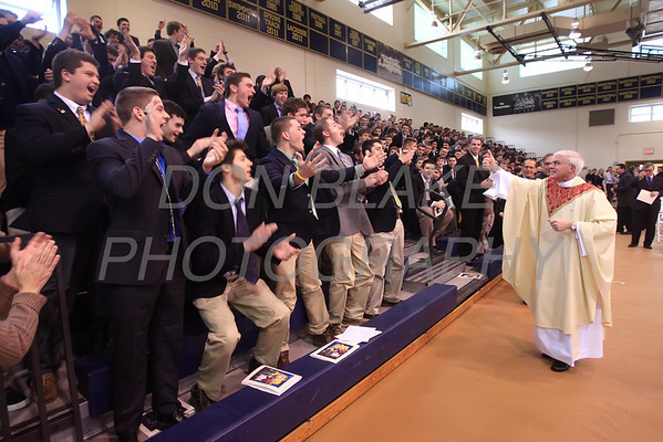 Newly Ordained Fr. Mike Vogt receives a rousing cheer from student after his Ordination in the Gym of Salesianum School, Wilmington, Del., Friday, January 27, 2012. Mike Vogt ask Bishop Malooly for permission to have his Ordination in the gym of Salesianum School where he is a teacher. photo/Don Blake Photography.com