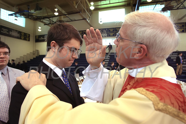 Newly Ordained Fr. Mike Vogt bless Salesianum senior Kevin Burns after his Ordination in the Gym of Salesianum School, Wilmington, Del., Friday, January 27, 2012. Mike Vogt ask Bishop Malooly for permission to have his Ordination in the gym of Salesianum School where he is a teacher. photo/Don Blake Photography.com