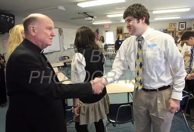 Bishop Malooly shakes hands with 12th grade student Jacob Diehl during his visit to Ss. Peter and Paul High School, January 11, 2012. photo/Don Blake Photography.com