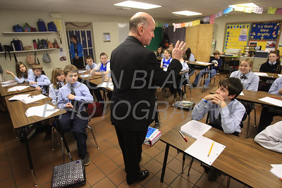 Bishop Malooly talks with middle school students during his visit to Ss. Peter and Paul School, January 11, 2012. photo/Don Blake Photography.com