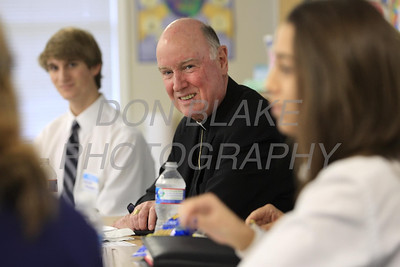 Bishop Malooly talks with students during his visit to Ss. Peter and Paul High School, January 11, 2012. photo/Don Blake Photography.com