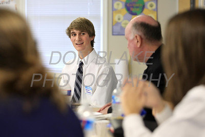 11th grade student Carter Saunders talks to Bishop Malooly during his visit to Ss. Peter and Paul High School, January 11, 2012. photo/Don Blake Photography.com