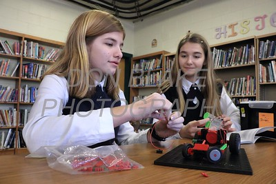 7th graders Hannah Beattie and Gwyneth Southhard work on a lago robot at Holy Cross School. www.DonBlakePhotography.com