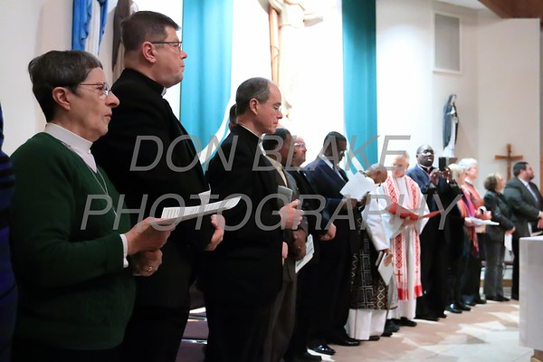 Clergy members gather on the alter during a Community Prayer Service for Justice, Non-Violence, and Respest for Human Dignity at St. Catherine of Siena, Tuesday, January 17, 2017.