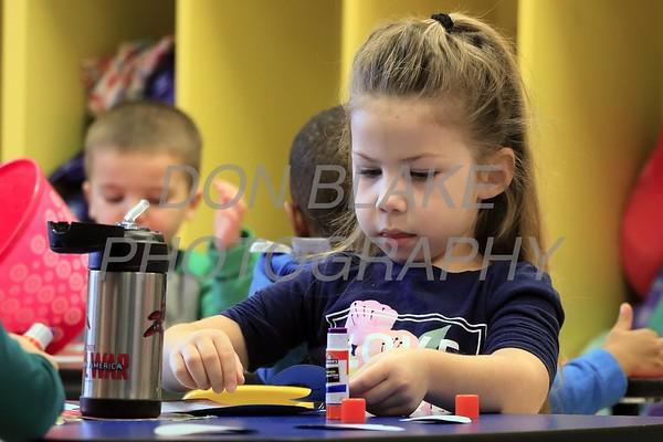 McKenzie Malczewski works on her school work at Holy Cross School. www.DonBlakePhotography.com