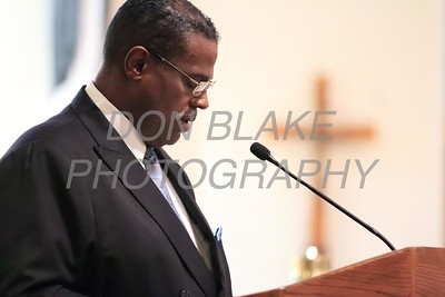Dr. Silvester Beaman of Bethel African Methodist Episcopal Church reads a reading during a Community Prayer Service for Justice, Non-Violence, and Respest for Human Dignity at St. Catherine of Siena, Tuesday, January 17, 2017. wwwDonBlakePhotography.com