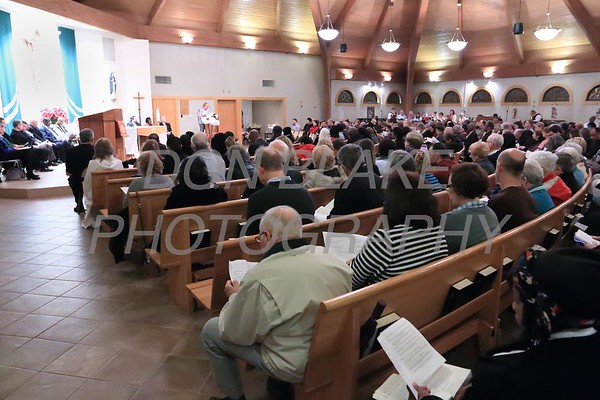 People pack St. Catherine of Siena during a Community Prayer Service for Justice, Non-Violence, and Respest for Human Dignity at St. Catherine of Siena, Tuesday, January 17, 2017.