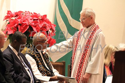 Rev. Dr. Vincent Oliver of New Mt. Calvary Baptist Church and Fr. John Hynes of St. Catherine of Siena during a Community Prayer Service for Justice, Non-Violence, and Respest for Human Dignity at St. Catherine of Siena, Tuesday, January 17, 2017.