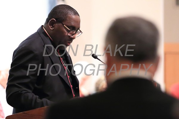 Bishop Dr. George Gibson of Christian Love Worship Cathedral reads a prayer during a Community Prayer Service for Justice, Non-Violence, and Respest for Human Dignity at St. Catherine of Siena, Tuesday, January 17, 2017. wwwDonBlakePhotography.com