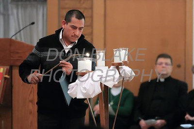 Noe Trujilla a parishioner of  St. Catherine of Siena lights a candle during a Community Prayer Service for Justice, Non-Violence, and Respest for Human Dignity at St. Catherine of Siena, Tuesday, January 17, 2017. wwwDonBlakePhotography.com