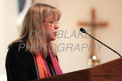 Rev. Martha Kirkpatrick of St. Barnabas Episcopal Church reads a prayer during a Community Prayer Service for Justice, Non-Violence, and Respest for Human Dignity at St. Catherine of Siena, Tuesday, January 17, 2017. wwwDonBlakePhotography.com