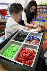 6th graders Ethan Stand and Tali Keen work on a lago robot at Holy Cross School. www.DonBlakePhotography.com