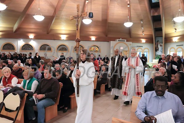 Rev. Dr. Vincent Oliver of New Mt. Calvary Baptist Church and Fr. John Hynes of St. Catherine of Siena process to the ater during a Community Prayer Service for Justice, Non-Violence, and Respest for Human Dignity at St. Catherine of Siena, Tuesday, January 17, 2017. wwwDonBlakePhotography.com