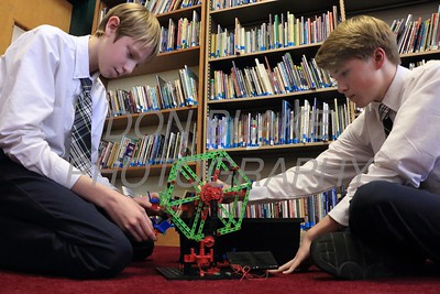 8th graders Smith Easton and Chase Bifferato work on a lago robot at Holy Cross School. www.DonBlakePhotography.com