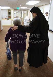 Sr. Mary Daniel walks with McGowan who was a long time parishioner of Sacred Heart Church and is now a resident at Kentmere Nursing and Rehabilitation Center. photo/Don Blake Photography.co