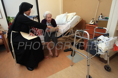 Sr. Mary Daniel visits with McGowan who was a long time parishioner of Sacred Heart Church and is now a resident at Kentmere Nursing and Rehabilitation Center. photo/Don Blake Photography.co
