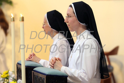 Sr. Audrey Francis Moran and Sr. Michele Elizabeth Socorso who is celebrating her 50th year Anniversary kneels during the Ceremony or Perpetual Profession at Immaculate Conception Church in Elkton. photo/www.DonBlakePhotography.com