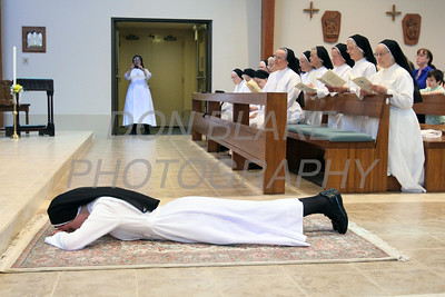 Sr. Audrey Francis Moran prostrates herself before the alter as Oblate Sisters of Saint Francis de Sales and all in attendance pray during her Ceremony or Perpetual Profession at Immaculate Conception Church in Elkton. photo/www.DonBlakePhotography.com