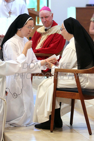Sr. Audrey Francis Moran kneels before Mother Francoise Bernadette as she recites her vows during her Ceremony or Perpetual Profession at Immaculate Conception Church in Elkton. photo/www.DonBlakePhotography.com