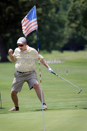 Bill Shinn celebtares after sinking a long putt on the 9th hole during the 24th Annual CYM Golf Tournament at Cavalier Country Club, Monday, July 18, 2016. wwwDonBlakePhotography.com
