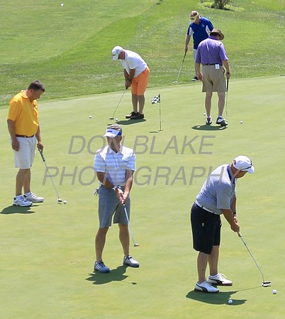 Golfers warm up on the prcatice green during the 24th Annual CYM Golf Tournament at Cavalier Country Club, Monday, July 18, 2016. wwwDonBlakePhotography.com