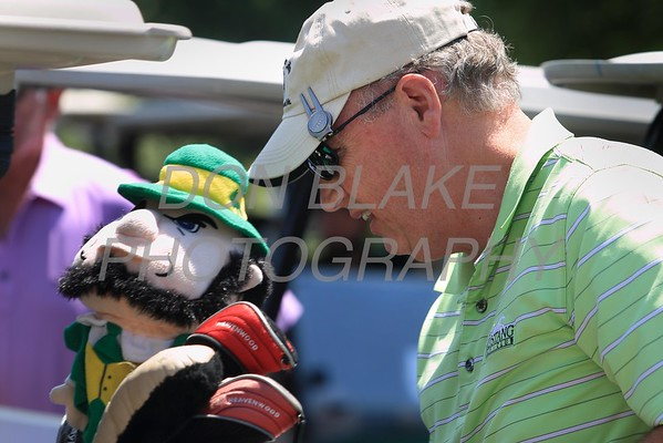 Tony McDonald checks his clubs before hitting the course during the 24th Annual CYM Golf Tournament at Cavalier Country Club, Monday, July 18, 2016. wwwDonBlakePhotography.com