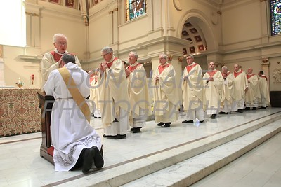 Lance Martin kneels as priests of the Diocese lay hands on his head during his Ordination at the Cathedral of St. Peter, Saturday, May 28, 2016. wwwDonBlakePhotography.com