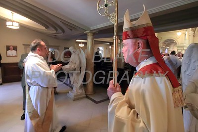 Lance Martin processes in as Bishop Malooly watches during his Ordination at the Cathedral of St. Peter, Saturday, May 28, 2016. wwwDonBlakePhotography.com