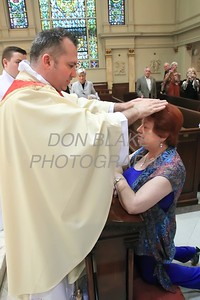 Lance Martin gives a blessing to his mother Joyce after his Ordination at the Cathedral of St. Peter, Saturday, May 28, 2016. wwwDonBlakePhotography.com