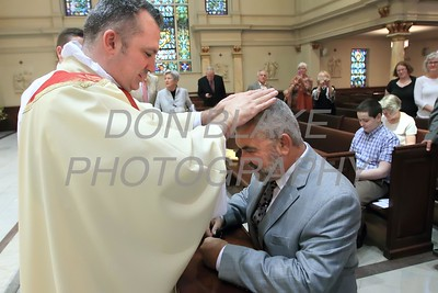 Lance Martin gives a blessing to his father Ed after his Ordination at the Cathedral of St. Peter, Saturday, May 28, 2016. wwwDonBlakePhotography.com