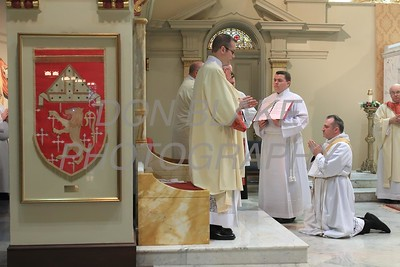 Lance Martin kneels before Bishop Malooly during his Ordination at the Cathedral of St. Peter, Saturday, May 28, 2016. wwwDonBlakePhotography.com