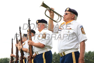 John Morrow from VFW Post 475 and Veteran of the Vietnam War plays tap during the 57th Annual Memoral Day Field Mass at All Saints Cemetery, May 30, 2016. wwwDonBlakePhotography.com