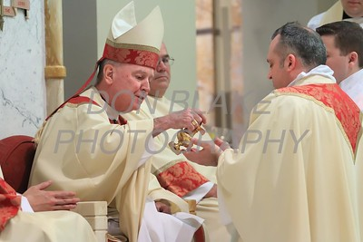 Lance Martin hands are anoited by Bishop Malooly during his Ordination at the Cathedral of St. Peter, Saturday, May 28, 2016. wwwDonBlakePhotography.com