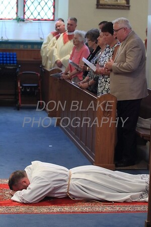 Lance Martin prostrates him self before Bishop Malooly's at St. Ann Church during Lance's Ordination to the Diaconate, Sunday, 7, 2015. wwwDonBlakePhotography.com