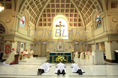Christopher Coffiey (left). Glenn Evers, and Brian Lewis prostrate on the alter during their Ordination to the Transitional Deacons at the Cathedral of St. Peter, Saturday 16, 2012. photo/www.DonBlakePhotography.com