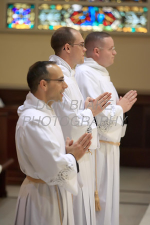 Brian Lewis (left). Glenn Evers, and Christopher Coffiey stand before Bishop Malooly during their Ordination to the Transitional Deacons at the Cathedral of St. Peter, Saturday 16, 2012. photo/www.DonBlakePhotography.com