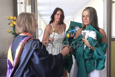 St. Mark's art teacher Linda Grieco gives graduates Kelsey Powell and Breanna Howell their flowers before the commencement ceremony at St. Mark's High School, Saturday, June 2, 2012. photo/ www.DonBlakePhotography.com
