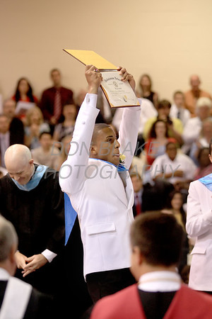 Salesianum graduate Cameron Granger holds up the diploma as the rest of the graduates cheer during the commencement ceremony at Salesianum School, Friday, June 1, 2012. photo/ www.DonBlakePhotography.com