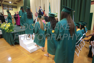 St. Mark's graduates process on to the stage to get their diplomas during the commencement ceremony at St. Mark's High School, Saturday, June 2, 2012. photo/ www.DonBlakePhotography.com