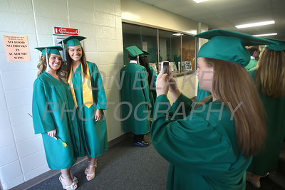 St. Mark's graduate Adrienne Newton and BreAnn Janvier have theri picture taken by Lindsay Dempsey before the commencement ceremony at St. Mark's High School, Saturday, June 2, 2012. photo/ www.DonBlakePhotography.com