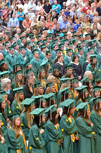 St. Mark's Graduates stand for the National Anthem and Invocation during the commencement ceremony at St. Mark's High School, Saturday, June 2, 2012. photo/ www.DonBlakePhotography.com