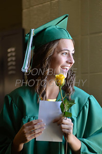 St. Mark's graduate Laura Cooney smiles as she is given her yellow rose before the commencement ceremony at St. Mark's High School, Saturday, June 2, 2012. photo/ www.DonBlakePhotography.com