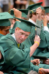 St. Mark's graduate Nick Ortolano moves his tassel from the right to the left during the commencement ceremony at St. Mark's High School, Saturday, June 2, 2012. photo/ www.DonBlakePhotography.com