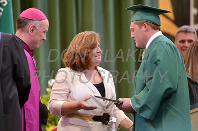 Linda Sommermann who is a teacher at St. Mark's hands her son Brandon Sommermann his diploma during the commencement ceremony at St. Mark's High School, Saturday, June 2, 2012. photo/ www.DonBlakePhotography.com