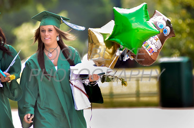 St. Mark's graduate Breannna Howell looks for family members after the commencement ceremony at St. Mark's High School, Saturday, June 2, 2012. photo/ www.DonBlakePhotography.com