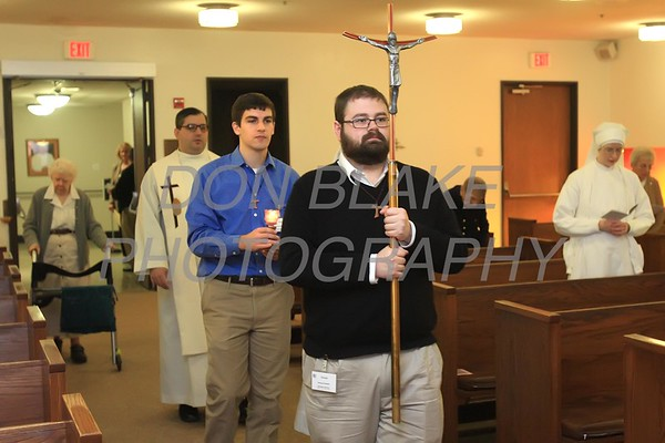 Dennis Bennett, and Casey Cole serve during station of the cross at Little Sisters of the Poor's Jeanne Jugan Residence. Casey and Dennis are Franciscan novice who are volunteering at Jeanne Jugan. photo/ www.DonBlakePhotography.com