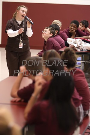 Elizabeth Nolan talks during her presentation to Christ the Teacher students about her life with Down Syndrome. photo/ www.DonBlakePhotography.com